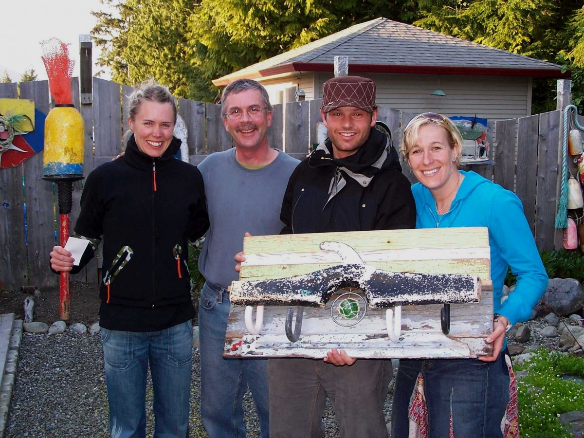 Artist Pete Clarkson pictured with 3 Canadian Olympians from 2010