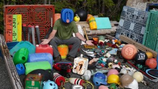 Pete with marine and tsunami debris